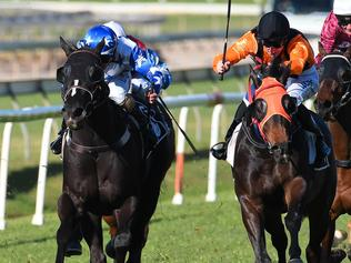 Jockey Luke Dittman rides Anzio (right) to win race 7, the CLAYFIELD JEWELLERY Class 3 Plate during the Clayfield College Raceday at Doomben Racecourse in Brisbane, Saturday, August 19, 2017. (AAP Image/Albert Perez) NO ARCHIVING, EDITORIAL USE ONLY