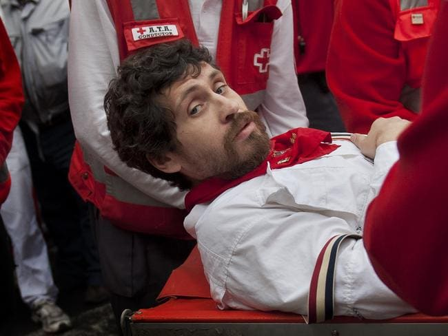 Bad advice ... Hillmann is carried on a stretcher after being gored on his right leg during the running of the bulls at the San Fermin festival in Pamplona, Spain. Picture: AP