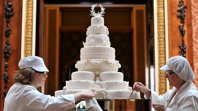 Rachel Jane Eardley and Diane Pallett put the finishing touches to the Royal wedding cake. Picture: AP