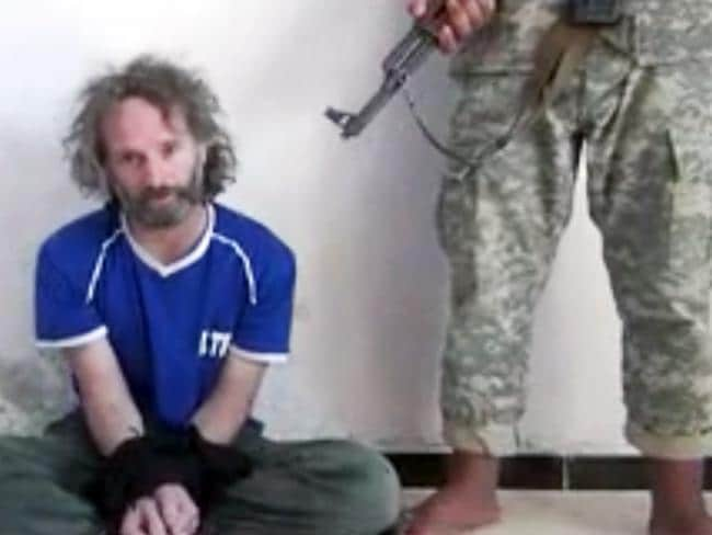 Peter Theo Curtis, a U.S. citizen held hostage by an al-Qaida linked group in Syria, delivers a statement.