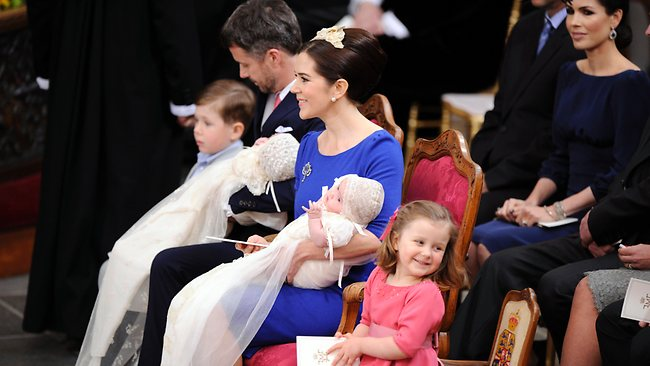 Princess Isabella flashes a cheeky grin during the christening ceremony / AP