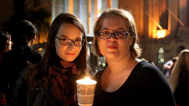 -Stephanie Kamering and Shannon McCallum of Keperra at the Memorial walk for French student Sophie Collombet.