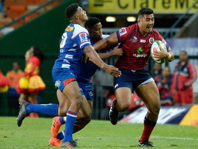 Reds' prop Sef Fa'agase on the charge.