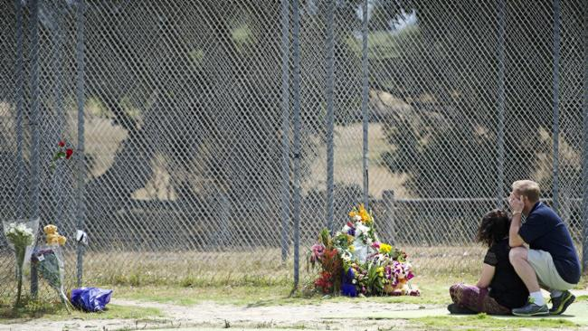 A couple, who did not know Luke Batty or his family pay their respects at the batting cag
