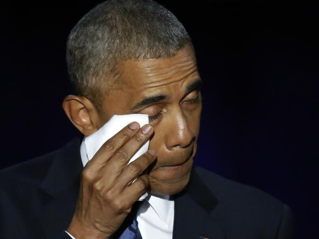 President Barack Obama wipes his tears as he acknowledges his wife, Michelle. Picture: AP