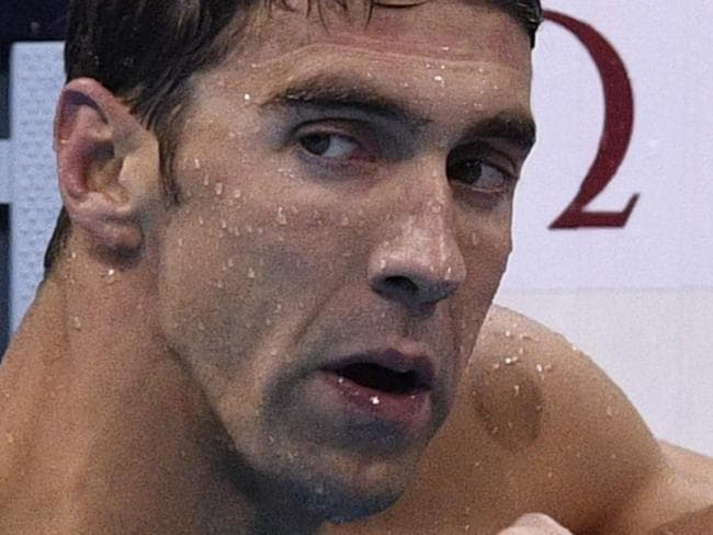 (FILES) This file photo taken on August 11, 2016 shows USA's Ryan Lochte (R) next to USA's Michael Phelps after they competed in the Men's 200m Individual Medley Final during the swimming event at the Rio 2016 Olympic Games at the Olympic Aquatics Stadium in Rio de Janeiro.   Six-time Olympic gold medalist Ryan Lochte said on July 14, 2017 he's not quite ready to plunge back into competition in the wake of his 10-month ban after family duties disrupted his recent training, website Floswimming.com reported.Lochte, who was banned by USA Swimming over his bogus gunpoint robbery story that embarrassed Rio Olympics organizers last year, welcomed the birth of son Caiden with fiancee Kayla Rae Reid last month. / AFP PHOTO / Martin BUREAU
