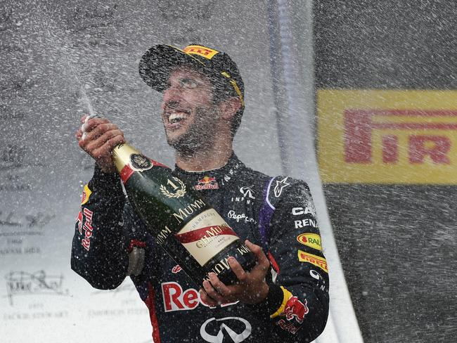 Then it's time for some champagne spraying on the podium and flashing a smile as wide as they come.