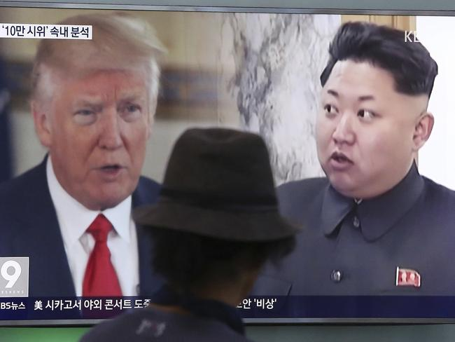 A man in Seoul, South Korea watches a television screen showing US President Donald Trump and North Korean leader Kim Jong-un. Picture: AP