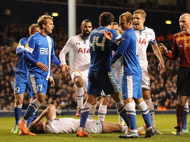 Roman Zozulya (the rightmost guy in blue) laughs at Jan Vertonghen for being so silly. But wait ... here comes the ref.