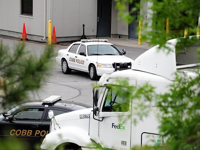 Six people were injured when a gunman opened fire at a FedEx station.