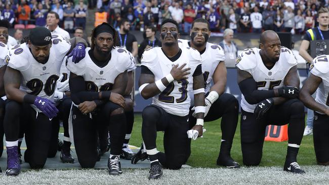 Baltimore Ravens players kneeling together. Pic: AP