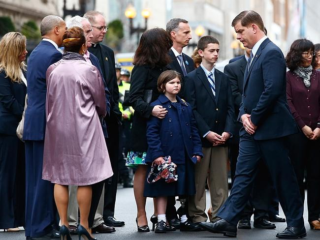 Tribute ... Boston Mayor Marty Walsh participates in a wreath-laying ceremony with members of the Boston Marathon bombings victims' families. Picture: Jared Wickerham