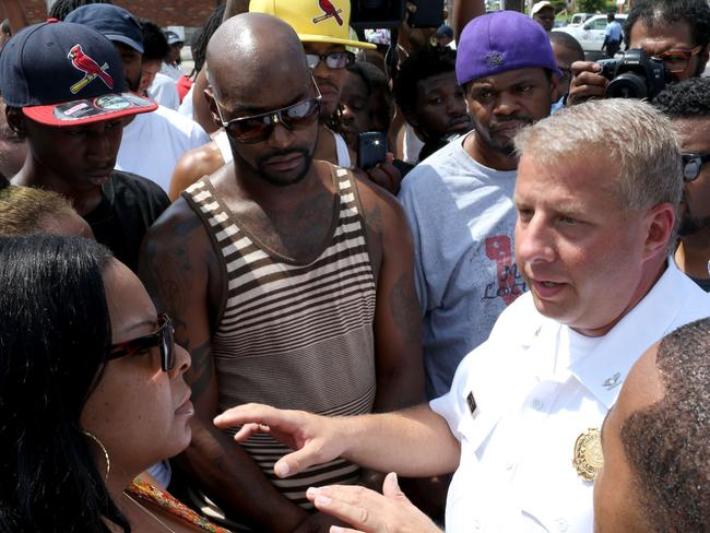 Tense situation ... St Louis police Chief Sam Dotson explains to a crowd of people what occurred.