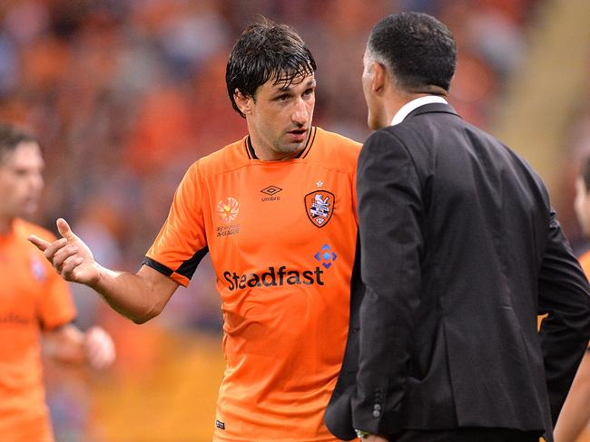\Thomas Broich of the Roar talks tactics with John Aloisi.