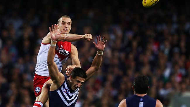 Fist ... Ted Richards smashes the ball away from Matthew Pavlich.