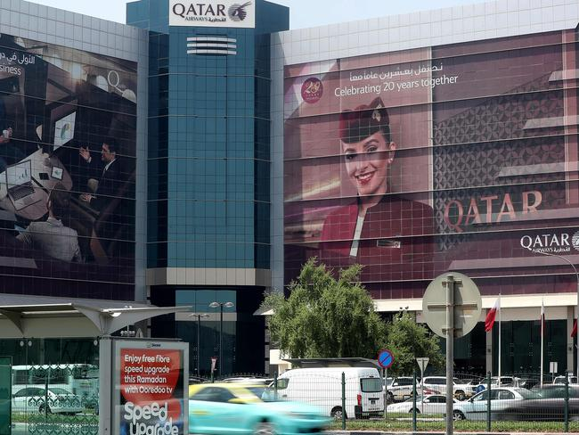 Cars drive past the Qatar Airways office in Doha following a ban on Qatari flights imposed by Saudi Arabia and its allies. Picture: AFP