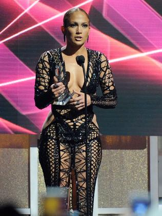 J Lo accepts an award onstage. Picture: Getty