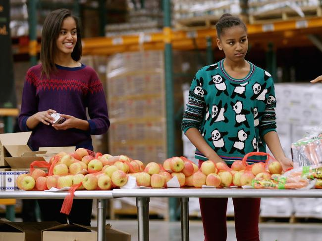 Malia, then 15, and Sasha, then 12, pictured in 2013. Picture: Chip Somodevilla/Getty Image
