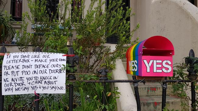 "A Sydney couple have put out a rainbow-striped ""Yes vote"" letterbox to support same sex marriage, only to have it defaced with black paint and poo dumped on their doorstep"