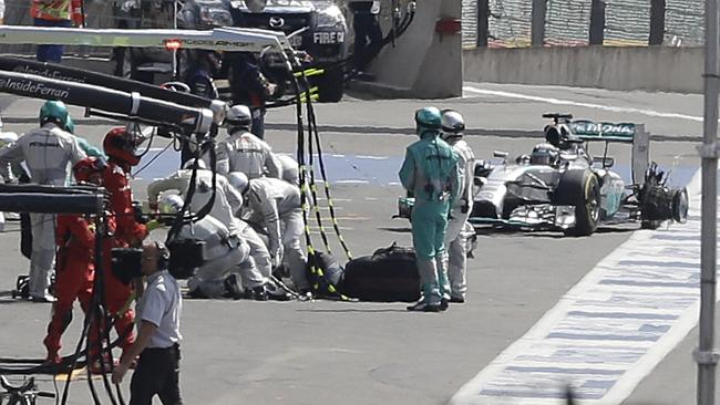 Hamilton crawled back to the pits with a puncture.