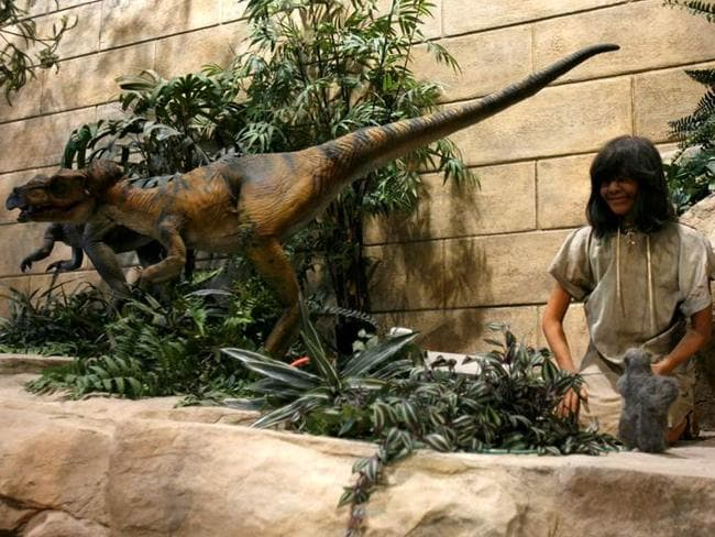 Humans and dinosaurs lived side by side according to the Creation Museum, as this exhibit illustrates. Photo supplied by the Creation Museum.