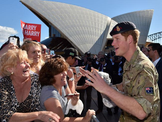 Prince Harry, above at the Sydney Opera House in 2015, will return as a married man with his glamorous bride Meghan Markle next year. Picture: Saeed Khan.