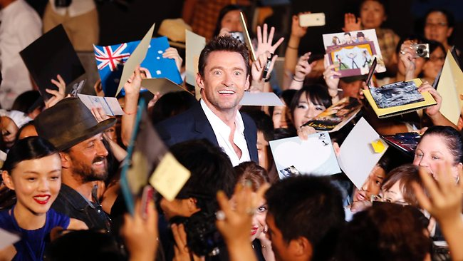 """Hugh Jackman (centre) smiles as he is mobbed by fans during the Japan premiere of his film """"The Wolverine"""" in Tokyo.Picture: AP"""