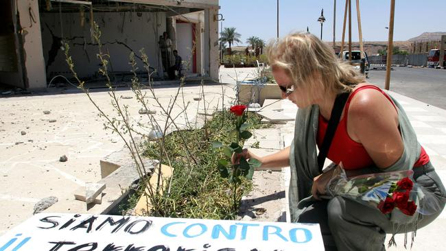 Mass casualties ... a tourist leaves a flower close to the scene of the Sharm el-Sheikh resort bombings in 2005.