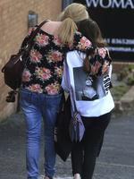 A fan is comforted as she leaves the Park Inn hotel in central Manchester, on May 23 2017. Picture: AP
