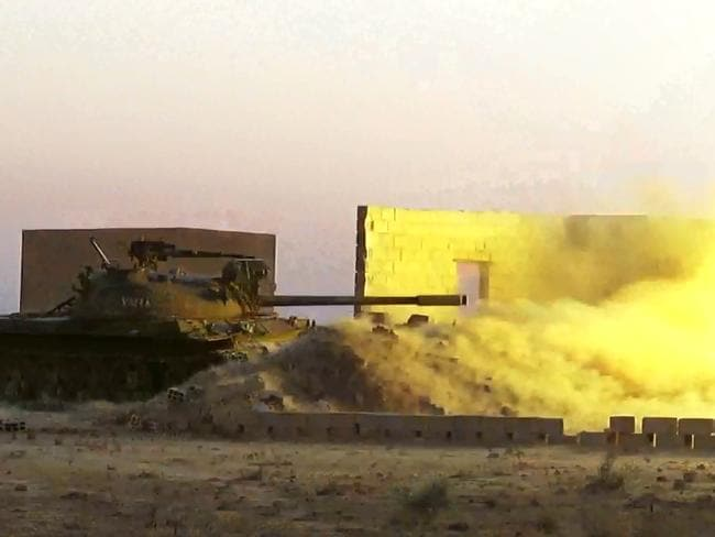 A captured tank is fired by fighters from the Islamic State group at the Tabqa air base in Syria. Picture: AP / Raqqa Media Centre of the Islamic State group