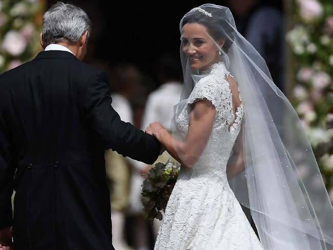 Pippa Middleton is escorted by her father Michael Middleton, as she arrives for her wedding to James Matthews at St Mark's Church in Englefield. Picture: AP
