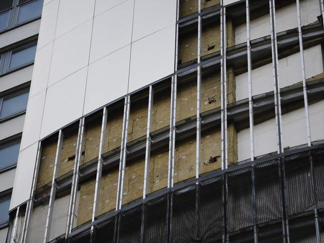 Panels of external cladding are removed from the facade of Braithwaite House in London in the wake of the Grenfell Tower fire. Picture: AFP/Tolga Akmen