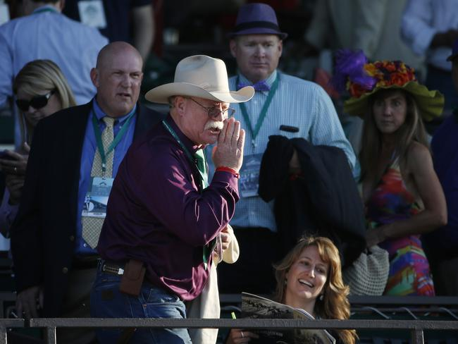 A furious California Chrome co-owner Steve Coburn yells from the grandstand at Belmont Park after his horse finished fourth in the Belmont Stakes. Picture: AP