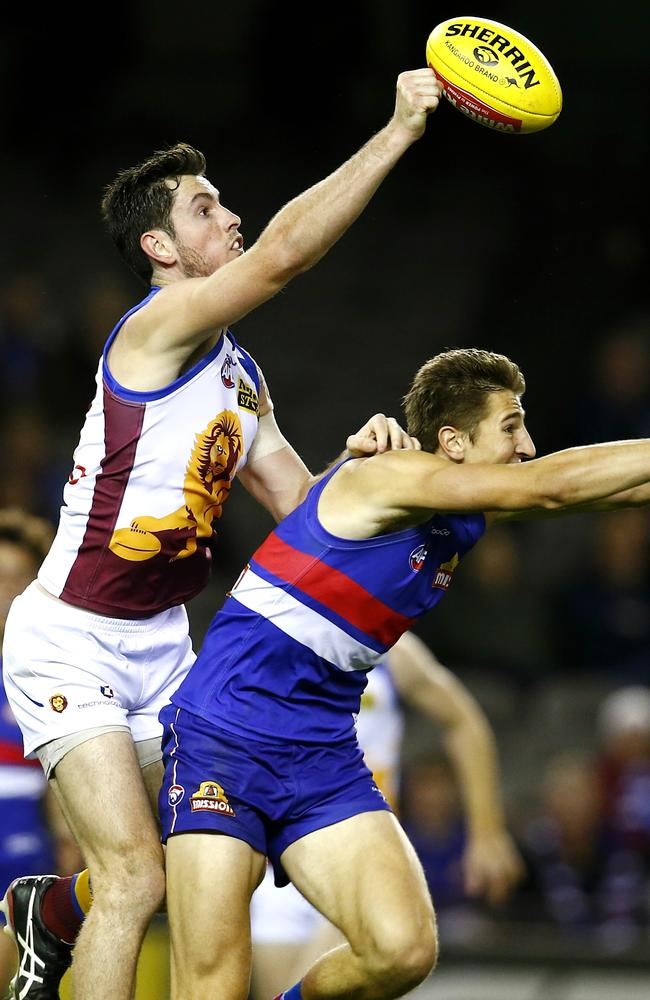 Darcy Gardiner punches the ball away from Marcus Bontempelli. Picture: Michael Klein