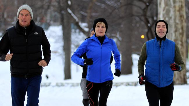 Work and pleasure ... Australian Foreign Minister Julie Bishop and her partner David Panton are given a morning jogging tour of Central Park in New York City by celebrity reporter and local New Yorker Nelson Aspen. Picture: Nathan Edwards
