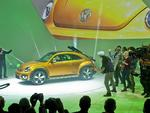 The Volkswagen Beetle Dune concept car is unveiled with performers at the 2014 North American International Auto Show in Detroit, Michigan. Picture: AP