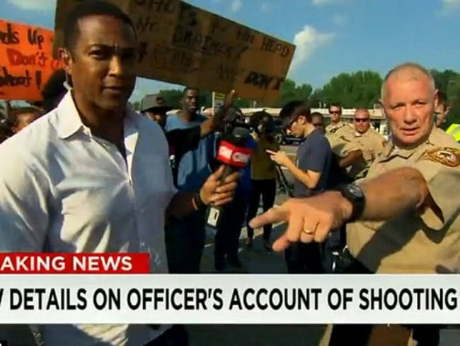 Internal review ... officer Dan Page allegedly shoved CNN anchor Don Lemon in the middle of a live report from Ferguson.