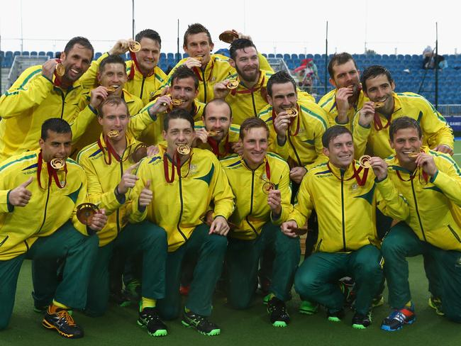 The Australia team celebrate with their gold medals after the final.