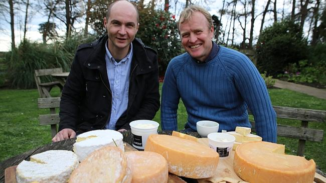 Cheesemaker Matthieu Megard, left, and Organic Dairy Farmers of Australia chief executive Bruce Symons with a selection of orga