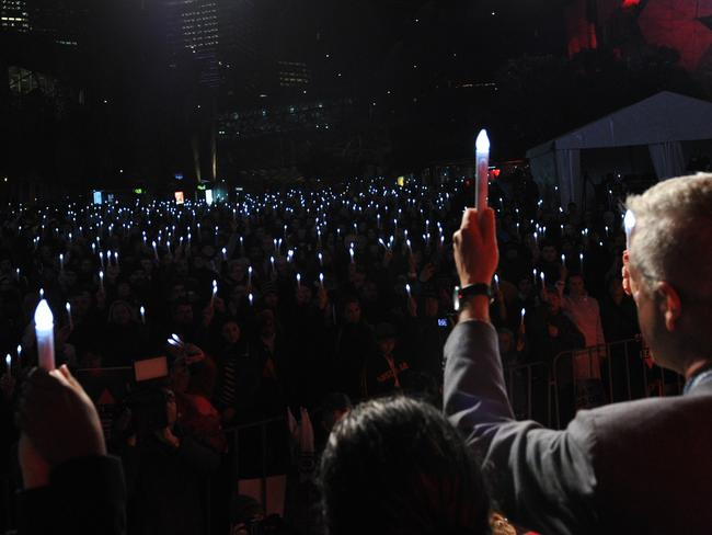People attend a candlelight vigil to remember delegates who lost their lives on-board Malaysia Airlines flight MH17 en route to the AIDS Conference 2014, at Federation Square in Melbourne. Picture: AFP