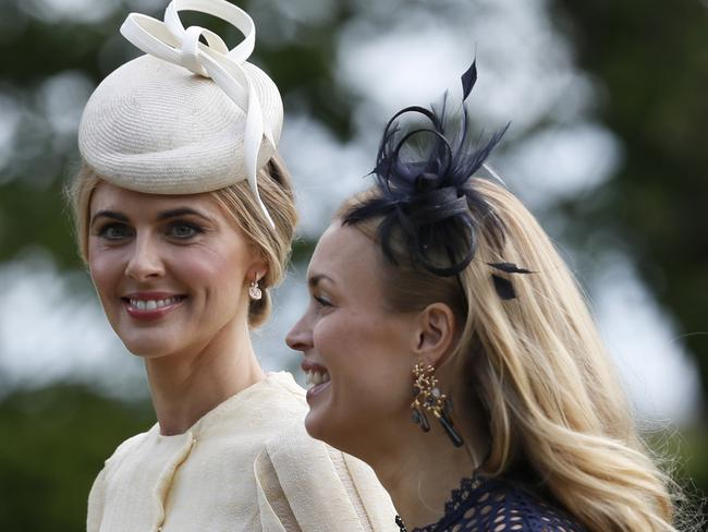 Media personality Donna Air, left, arrives at St Mark's Church. Picture: AP