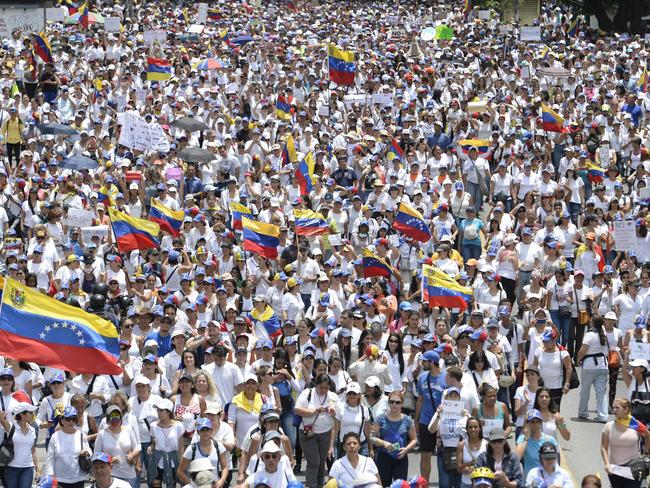 Venezuelan opposition activists take part in a women's march aimed to keep pressure on President Nicolas Maduro. Picture: Federico Parra/AFP