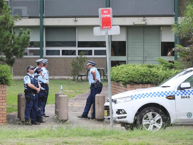 Police standing guard outside Woolooware High school after a bomb threat was issued. PICTURE: ROSS SCHULTZ