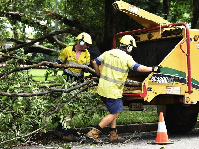 Darwin City Council workers clean up after Cyclone Blanche passed by Darwin, ripping down a few trees.