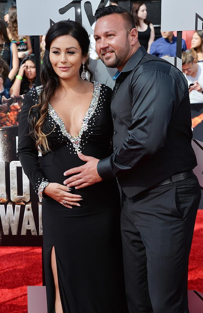 Jennifer 'JWoww' Farley and her fiance Roger Mathews attend the 2014 MTV Movie Awards at Nokia Theatre L.A.
