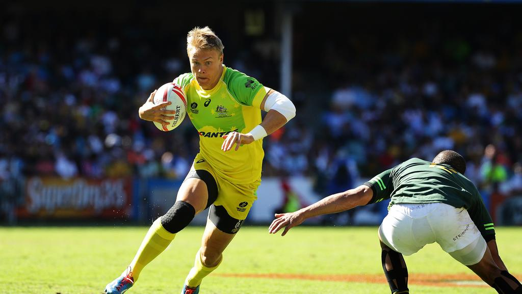 Australia's Tom Kingston takes on the South Africa defence at Allianz Stadium.