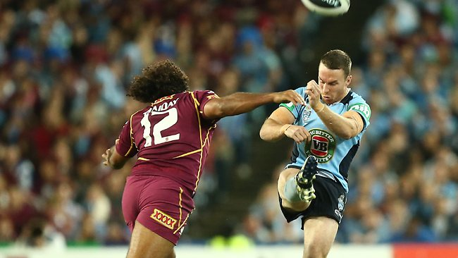 James Maloney gets a kick away as Sam Thaiday closes in. Picture: Mark Evans