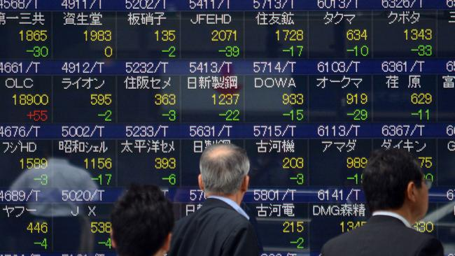 A nervous watch for stockholders ... investors watch price movements at the Tokyo Stock Exchange.