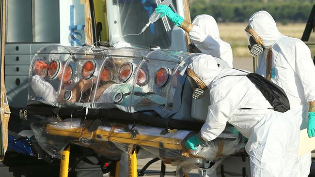 Roman Catholic priest Miguel Pajares, who contracted the deadly Ebola virus, being transported from Madrid's Torrejon air base to the Carlos III hospital upon his arrival in Spain. Pic: AFP.