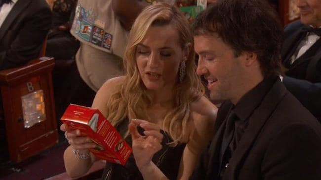 Kate Winslet nabs a box of cookies.
